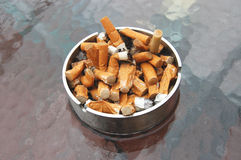 Wet cigarettes Royalty Free Stock Images