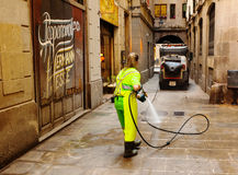 Wet cleaning of ancient streets  in Barcelona, Spain. BARCELONA, SPAIN - JUNE 1: Wet cleaning of ancient streets in June 1, 2013 in Barcelona, Spain Royalty Free Stock Photos