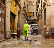 Wet cleaning of old streets   in Barcelona. BARCELONA, SPAIN - JUNE 1: Wet cleaning of old streets in June 1, 2013 in Barcelona, Spain Stock Images