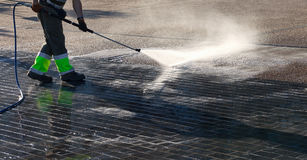 Wet cleaning of street. Royalty Free Stock Image