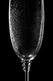 Wet and clear wine glass on black Royalty Free Stock Image