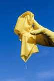 Wet cloth. Yelloow wet cleaning cloth in hand Stock Photos