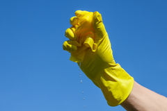Wet cloth. Yelloow wet cleaning cloth in hand Stock Image