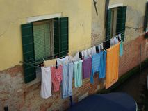 Wet clothes hanging near canal Royalty Free Stock Photos