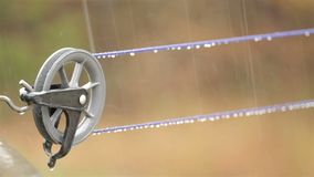 Wet clothes Line. Empty clothes line on a rainy day stock footage