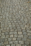 Wet cobbled Road Close up. Detail of a wet cobbled road in winter Royalty Free Stock Photos