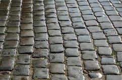 Wet cobbles of block pavement Stock Photo