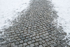 Wet cobbles with snow in winter Royalty Free Stock Photos