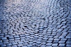 Wet Cobblestone. Rough texture of wet cobblestones, old side-street Stock Images