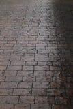 Wet cobblestone pavement after the rain Stock Photo