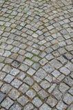 Wet cobblestone road Stock Photography