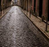 Wet cobblestone street lisbon Stock Photos