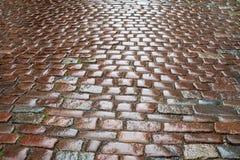 Wet cobblestones after rain Stock Photos