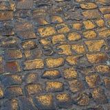 Wet cobblestones reflect the sun Stock Image