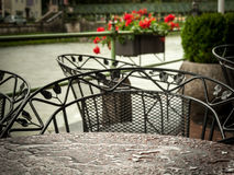 A wet coffee house table in rain Royalty Free Stock Images