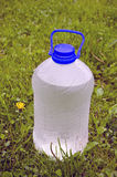 Wet cold drink water plastic bottle on grass Stock Images