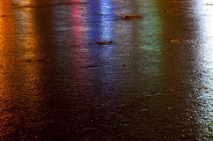 Wet colored asphalt. Asphalt after rain shine in different colors Royalty Free Stock Photo