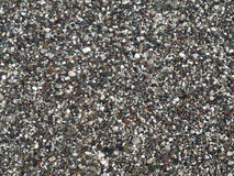 Wet colored pebbles background texture Stock Image