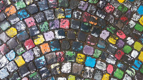 Wet colorful cobblestone street as a background Stock Images