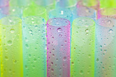 Wet colorful straws for juice Stock Photos