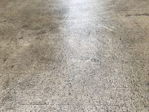 Wet concrete floor Stock Images