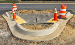 Wet concrete on new sidewalk construction stock photography