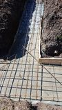 Wet concrete is poured on wire mesh steel reinforcement Stock Image