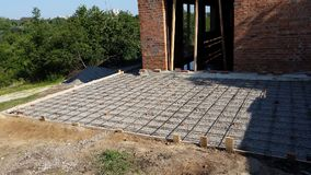 Wet concrete is poured on wire mesh steel reinforcement. Wen concrete is poured on wire mesh steel reinforcement on building Royalty Free Stock Photography