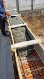 Wet concrete is poured on wire mesh steel reinforcement. Wen concrete is poured on wire mesh steel reinforcement on building Stock Photo
