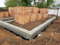 Wet concrete is poured on wire mesh steel reinforcement. Wen concrete is poured on wire mesh steel reinforcement on building Stock Images