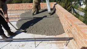 Wet concrete is poured on wire mesh steel reinforcement. Wen concrete is poured on wire mesh steel reinforcement on building Royalty Free Stock Images