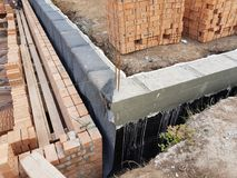 Wet concrete is poured on wire mesh steel reinforcement. Wen concrete is poured on wire mesh steel reinforcement on building Stock Photography