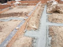 Wet concrete is poured on wire mesh steel reinforcement Stock Images