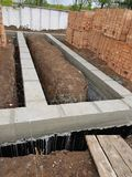 Wet concrete is poured on wire mesh steel reinforcement Royalty Free Stock Photo