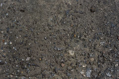 Wet concrete with water and small stones background texture Royalty Free Stock Photography