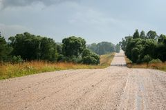 Wet country road. In Lithuania Stock Photo
