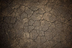 Wet cracked earth or dirt for textured background royalty free stock image