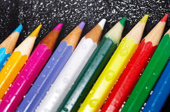 Wet crayons Stock Image