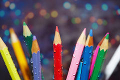 Wet crayons Stock Images