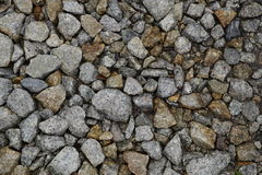Wet crushed stones of railway ballast Royalty Free Stock Photography