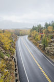 Wet  curved road in Acadia National Park Royalty Free Stock Image