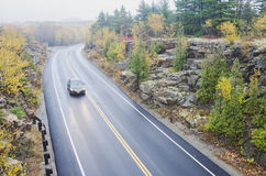 Wet  curved road in Acadia National Park Royalty Free Stock Photography