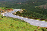 Wet curvy road. On the side of the steep hills in the Algarve, Portugal Stock Photos
