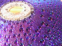Wet data. Water drops on a surface of compact disc Royalty Free Stock Photo