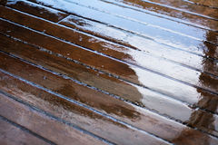 Wet deck planks on a sailing yacht Royalty Free Stock Image