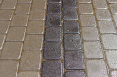 Wet decorative dark and light tiles Stock Image