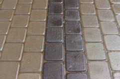 Wet decorative dark and light tiles Stock Image