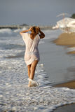 Wet dress. The girl in a wet shirt at coastline Stock Photo