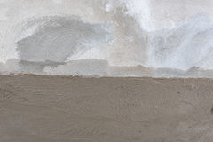 Wet and dry plaster concrete wall Stock Photo