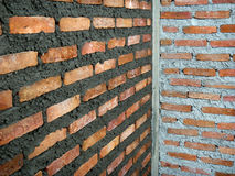 Wet and dry plaster red brick wall Background of brick wall texture Stock Images